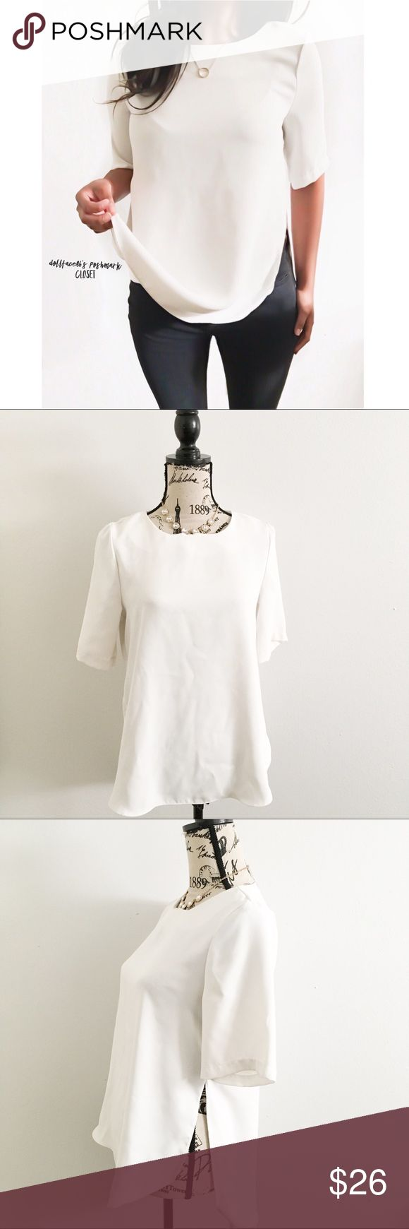 """Topshop White Split Side Blouse ✦   ✦{I am not a professional photographer, actual color of item may vary ➾slightly from pics}  ❥chest:19"""" ❥waist:21.5"""" ❥length:(about)27""""29"""" long in back ❥sleeves:11.5"""" side slits:(about)8.5"""" from waist ➳polyester/machine wash ➳fit:in my opinion like a small  ➳condition:gently used   ✦20% off bundles of 3/more items ✦No Trades  ✦NO HOLDS ✦No lowball offers/sales are final  ✦‼️BE A RESPONSIBLE BUYER PLS ASK QUESTIONS/USE MEASUREMENTS TO MAKE SURE THIS WILL…"""