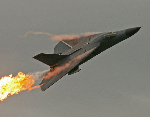 F-111 passing gas. Literally. The Dump And Burn was a favorite of Royal Australian Air Force F-111 Aardvark pilots. Dump some fuel, then light the afterburners. Instant flame trail. Not recommended during formation flying!