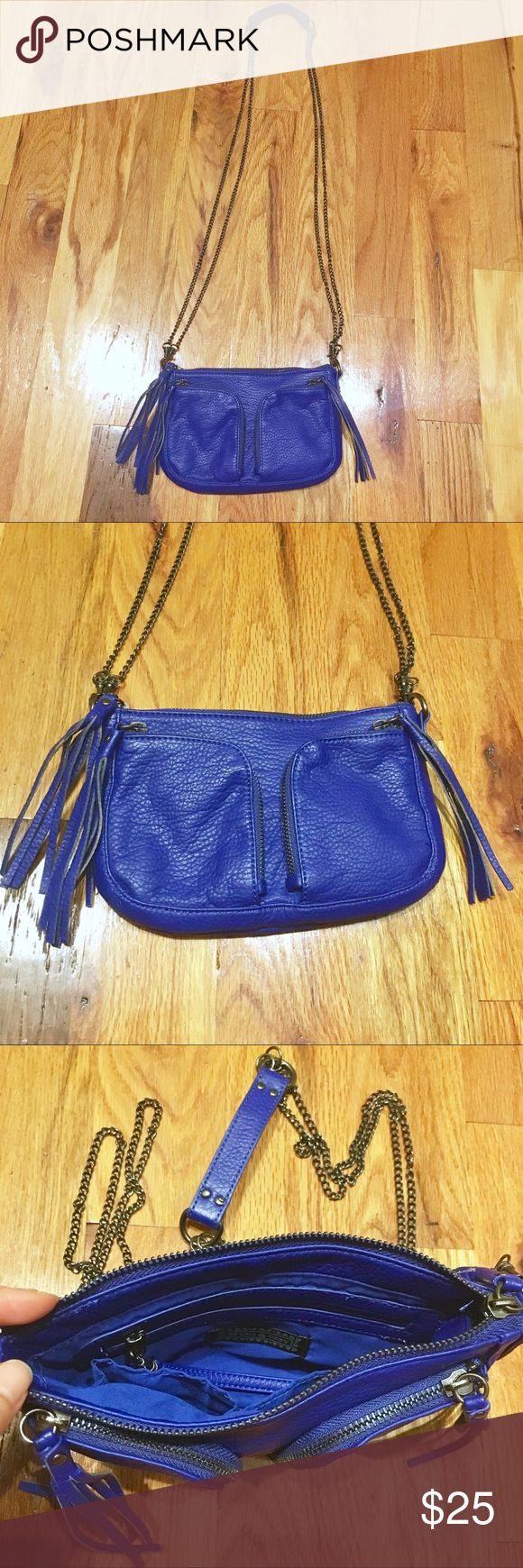 """Vegan faux leather purse 9x6 NWOT Deena & Ozzy vegan faux leather purse NWOT bought from Urban Outfitters.  9"""" x 6"""" with fringe tassels and detachable chain cross body shoulder strap (can be worn with the long chain strap or as a cute clutch), zippered pockets, vibrant blue and pebbled pleather, perfect condition. Deena & Ozzy Bags"""