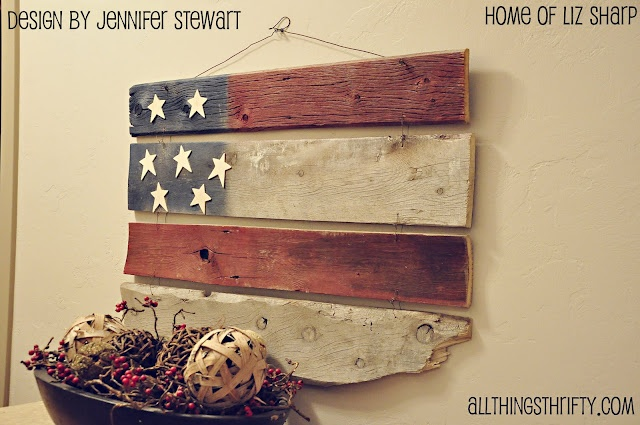 Oh how I am in LOVE with this one! Random barn wood pieces wired together create the perfect American flag. Isn't this something?