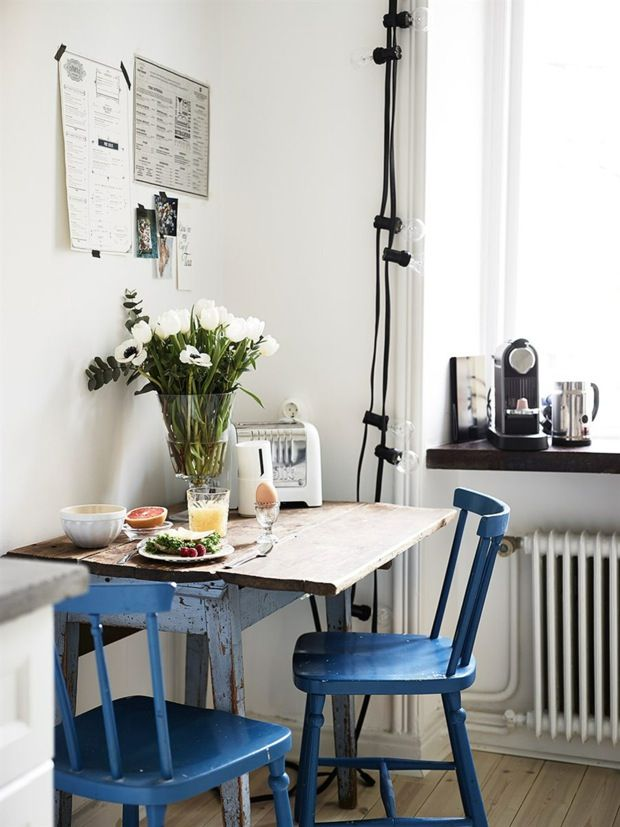 kitchen dining nook with blue vintage chairs