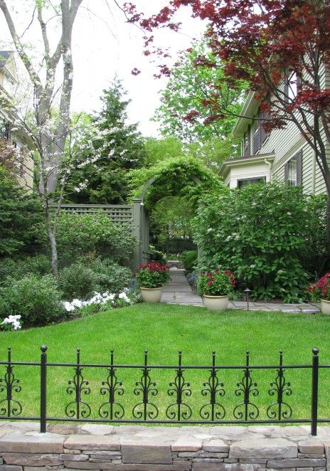 love the gorgeous fence, landscaped beautifully & inviting me to guess what it looks like on the other side