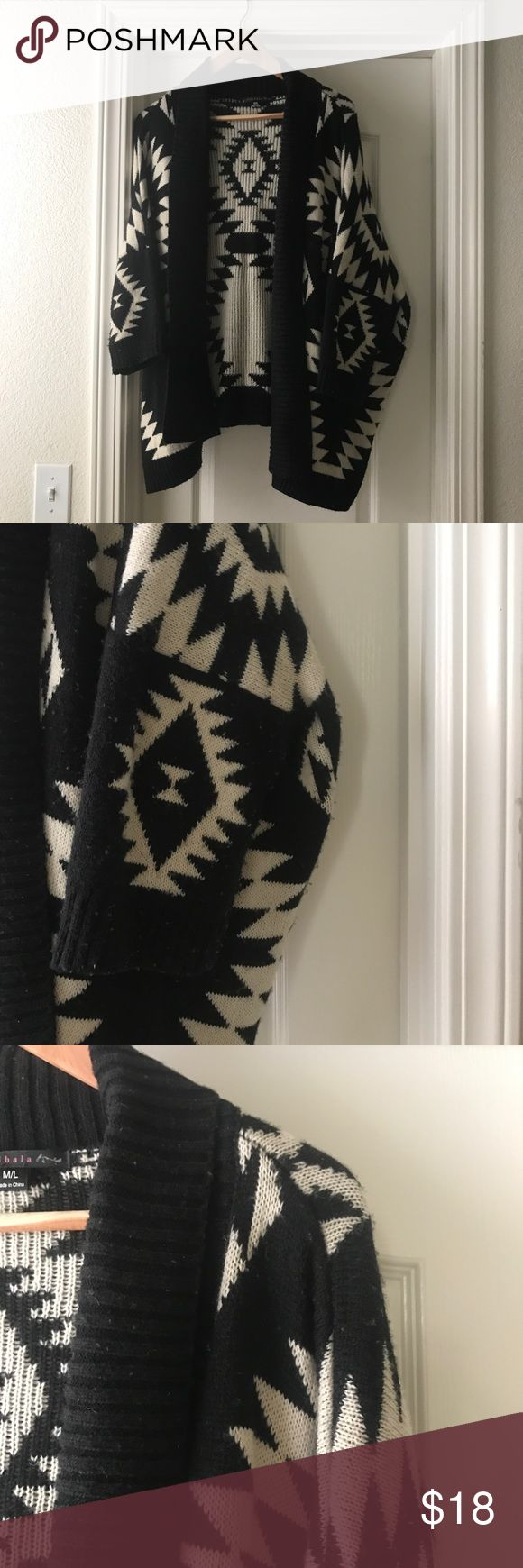 Chunky Boho Tribal Sweater Chunky sweater with a tribal pattern in black and white.  Size m/l, fits all sizes IMO. Super chunky, 3/4 length sleeves. Minor pilling! Sweaters Cardigans