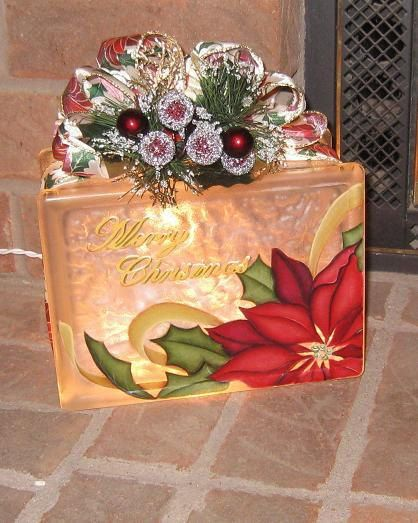 This Glass Poinsettia Block can be placed most anywhere you want to add a little light for the holiday decor. 6x8x4