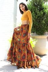 If you have bohemian style, it's likely that you'll love the artistic look of the Martina peasant maxi skirt in a stunning bohemian print. This skirt is both comfortable and feminine with a soft elastic waistband and A-line silhouette.  Each tier contains delicate gathers accented with rust orange piping for added texture.  The Martina is rich in texture, rich in color, and with the hidden side pockets, this will easily make its way to your top favs.  Pair it with a fitted top for th...