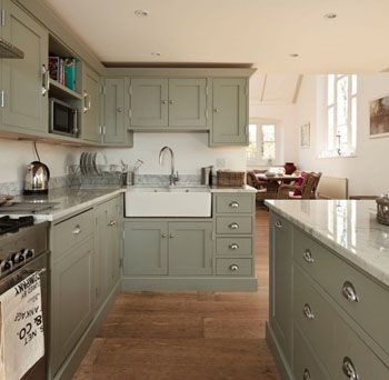 Sage green kitchen cabinets look terrific against a beige for Kitchen cabinets 50 off