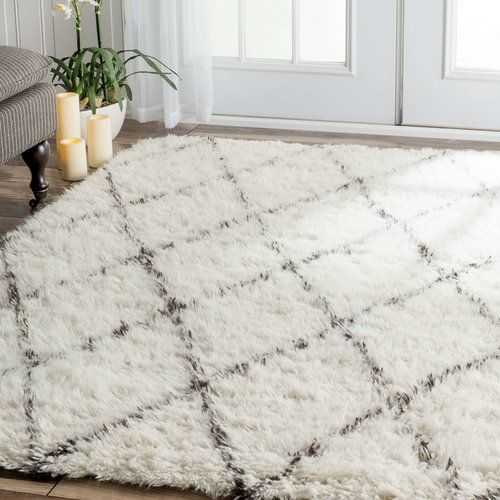 Found it at AllModern - Simonds Off-White/Brown Shag Area Rug  Great for living room with tan couch