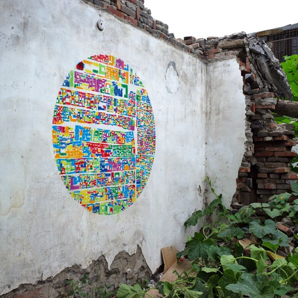 An Abstract Collage of Beijing Neighborhoods Creates a Colorful Stencil on a Dilapidated Courtyard Wall