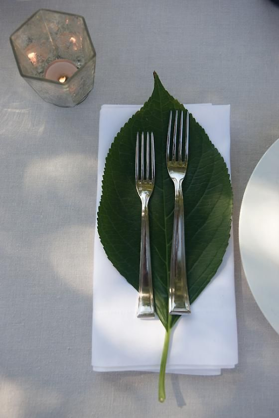 You can use a large leaf, placed on top of a napkin, to set off silverware. Simple yet elegant!