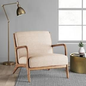 Classic style does a stylish about-face in this intriguing and exciting addition to your living space. This chair does it with alluring lines that flow beautifully from curved back to generously cushioned seat, and with shades of mid-century modern in its angle-set tapered legs.