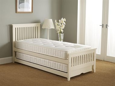 Ella Guest Bed - The Ella guest bed is a great space saver and ideal if you have visitors staying over.  The separate underbed glides neatly under the top bed when not in use, and can easily be pulled out and popped up so both beds are the same height - providing the option of a double bed or two singles.   Made from solid durable Acacia wood and available in a clean Ivory painted finish.