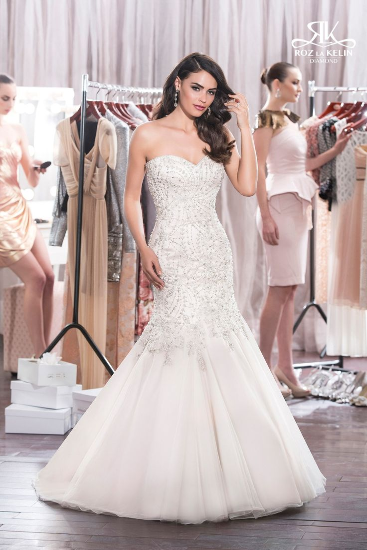 For the bride who loves bling, this Roz la Kelin gown is for you! This jewel-encrusted Mermaid is available in either lace-up or zip-up, and comes in white, ivory, or champagne (as shown)