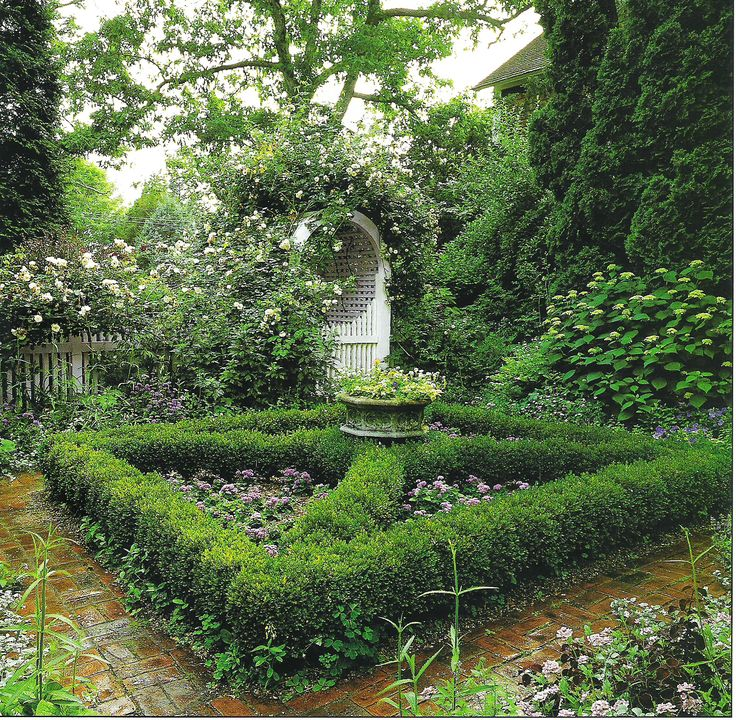 A Sweet Semi-formal Garden With Loosely Clipped Boxwood