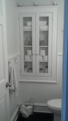 Bathroom cupboard built into spaces between wall studs