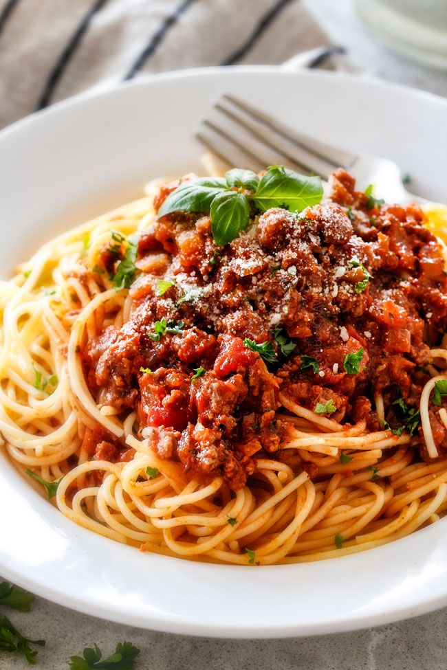Quick and easy Weeknight Spaghetti Bolognese bursting with flavor on your table in under 30 minutes but tastes like its been simmering all day! We make this recipe more than ANY OTHER RECIPE!