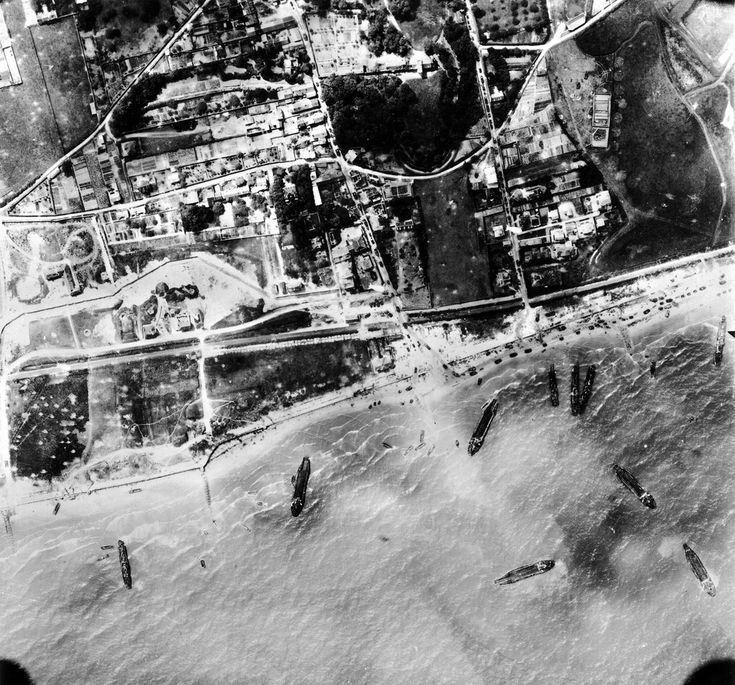 Aerial view of landing at Bernieres sur Mer Juno Beach sector, Nan White Beach. L to R: the Wn 28, an output by the Sea Street (see the line of tanks), a second kind by the Elm Street (see the line of armored) Tanks on the beach, there were traffic jams at Bernières led many to the beach.