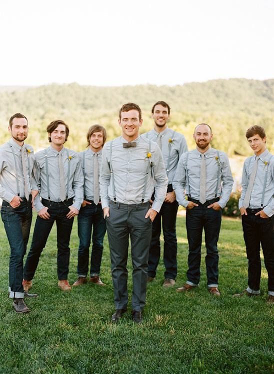 Jeans, chambray shirts, paired with sliver ties, grey suspenders and billy ball boutonnieres. Wedding style: rustic backyard; Wedding colors: grey, brown and yellow. Photo by Austin Gros Photographer, check out more here.