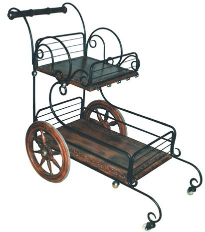 WOODEN IRON SERVING TROLLY Now Serve food From Kitchen To Dining Table On This Hand Carved Serving Trouley. A Beautiful Hand Carved Serving Trouley Developed From The Very High Quality Sheesham Wood This Beautiful Trouley/Cart Is Easy To Handle Things From Kitchen To Dining Table And Now Doesn't Need To Handle Two Plates In Two Times. You Can Serve Tea, Coffee, Snacks As Well As Food Or Anything Whatever You Like To Serve In This Beautiful Hand Carved Serving Trouley.