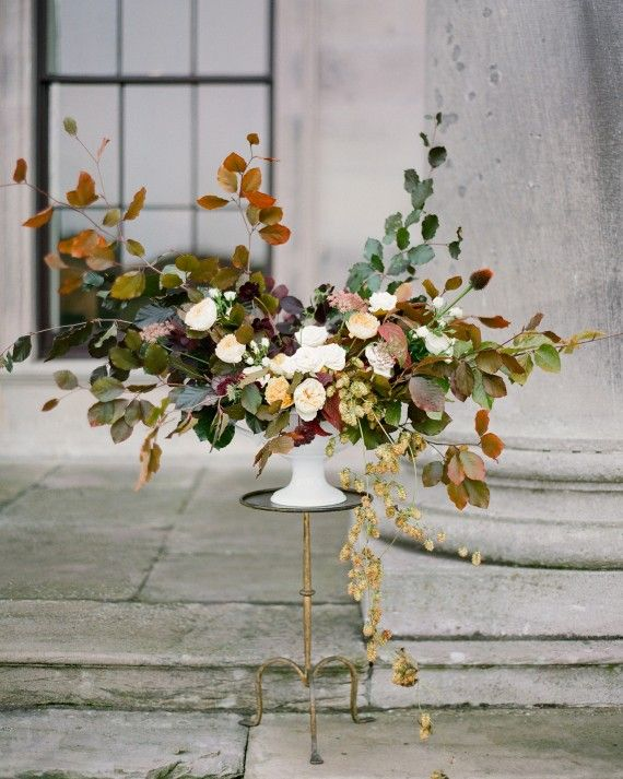 Dramatic displays of flowers, including Beatrice garden roses, Carmel Antique Garden roses, chocolate cosmos, and fall foliage including beech leaves and hops vines celebrated the season.