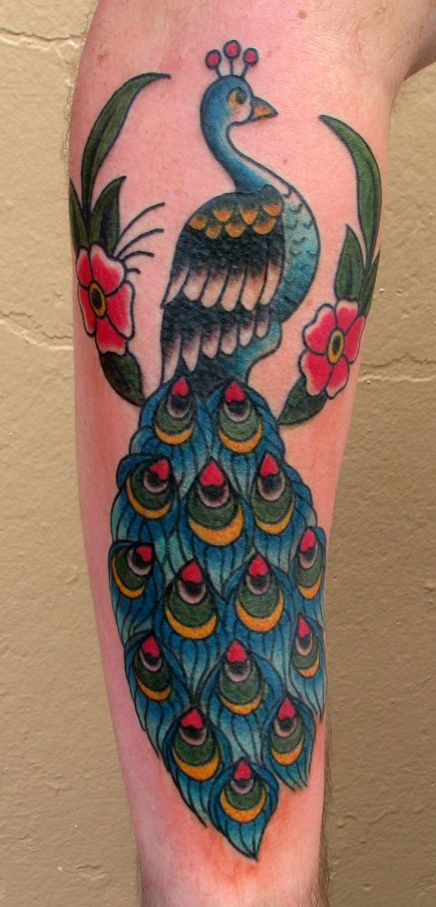 Sailor Jerry-style peacock tat