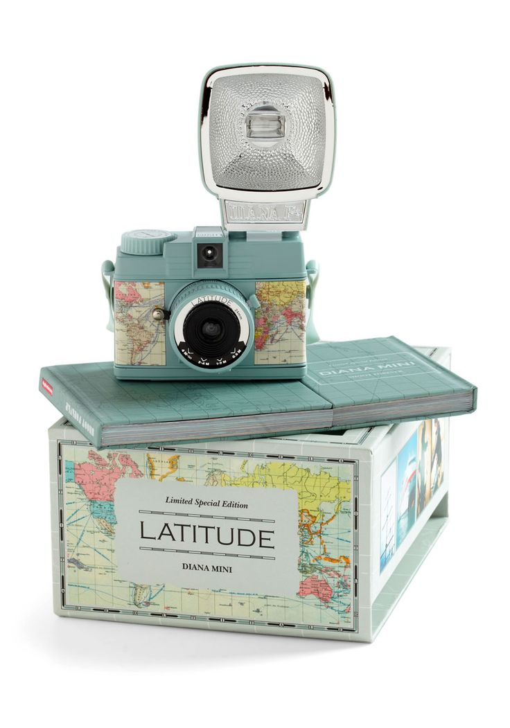 """newcomer, this travel-ready kit comes complete with a shoulder strap, a Diana Mini """"Shoot Forever"""" book, detachable flash with colored filters, an instruction manual, and lens cap. There's no doubt about it - all 205 grams of this too-cool camera will make your scrapbook picture perfect!"""