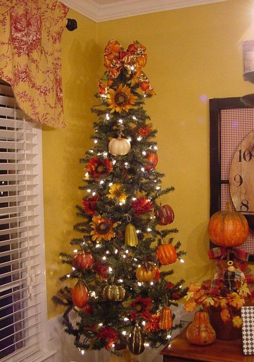 This is the year I make a Thanksgiving / Fall tree.  Will set up the artificial tree with only white lights and some fall ribbon and gold spray painted pinecones and a few silk sunflowers.  By Christmas I'll be halfway done - tree is up and the white lights are on.