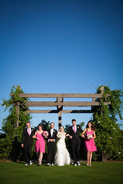 Hot pink wedding theme. Dresses from www.sweetheartsbridal.com.au. Suits from www.mantoman.com.au. Ties from www.lowes.com.au. Photo by Saxon Cole Photography. Location: Ceremonial Garden at Twin Creeks Golf and Country Club www.twincreeksgolf.com.au.