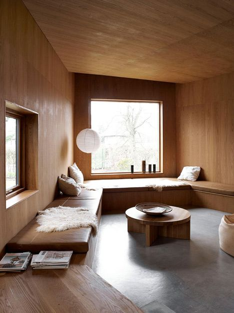 Architects Mette and Martin Wienberg have overhauled a 1940s cottage in Denmark to create a modern home for their family, complete with timber-lined walls and cosy furnishings.
