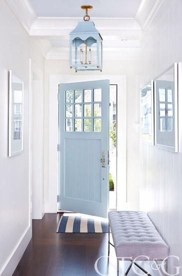 blue lantern pendant and blue door, stripe blue and white rug in entry