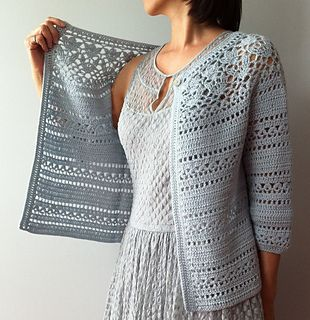 Irene - floral lace yoke cardigan by Vicky Chan  Featuring a floral lace yoke and a lacy stripe pattern, this feminine three-quarter sleeve cardigan is equally lovely dressed up or down.