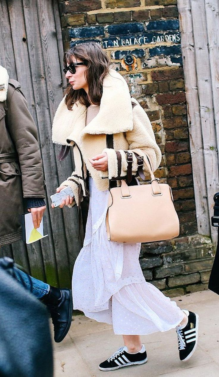 Irina Lakicevic in a Burberry Prorsum shearling jacket, a white cotton skirt and Adidas sneakers