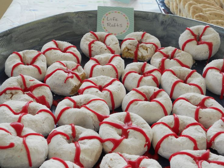 Life Rafts. Powdered Sugar donuts decorated with red frosting. Perfect pool…