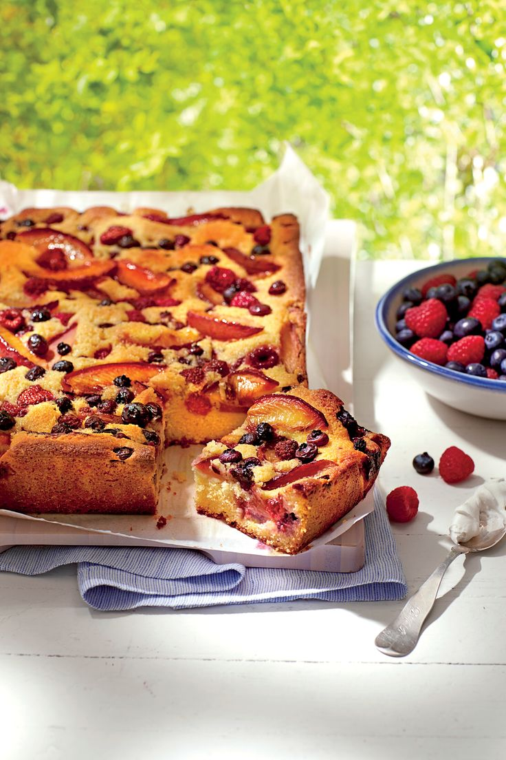 Plum-Berry Cornmeal Sheet Cake | Bake and take this easy-to-transport, fruit-filled dessert to any summer gathering.