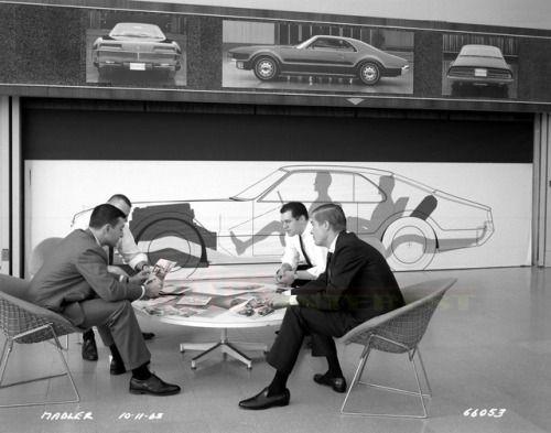1963  General Motors Stylist working on the 1966 Oldsmobile Toronado.   Location: GM Facilities - Warren, Michigan  Architect and Interiors - Eero Saarinen  Shown - Harry Bertoia Chairs - (Knoll) Charles and Ray Eames Alum Group Table (Herman Miller)