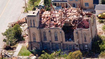 A-downtown-church-in-sits-in-ruins-in-Goderich-Ontario-after-the-tornado.jpg…
