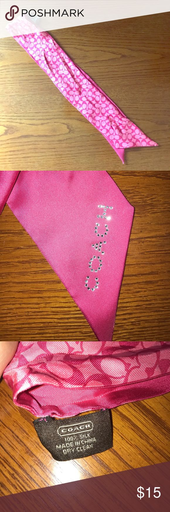 Coach Silk Scarf This Coach Scarf is 100% silk and features the Coach name written in rhinestones. Looks great tied to an existing Coach bag, but can also be worn in one's hair. Coach Accessories Scarves & Wraps