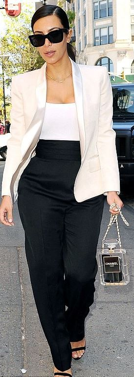 Kim Kardashian: Shirt – Alaia  Jacket and pants – Balmain  Purse – Chanel  Sunglasses – Celine
