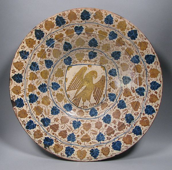 Dish Date: 1435–1465 Geography: Made in probably Manises, Valencia, Spain Culture: Spanish Medium: Tin-glazed earthenware Dimensions: Overall: 17 3/8 in. (44.1 cm) Classification: Ceramics