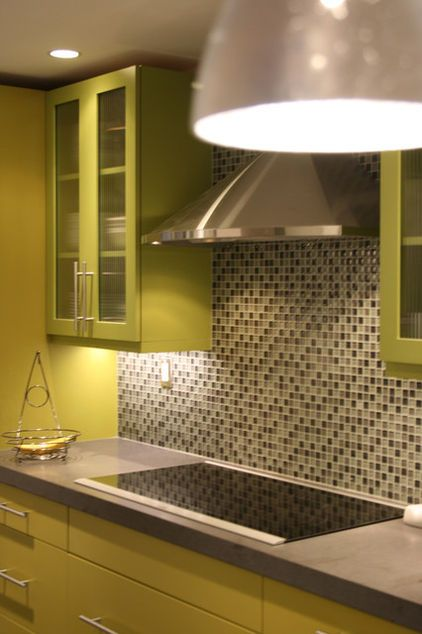 Green cabinet coat paint with gray worktop and mosaic wall