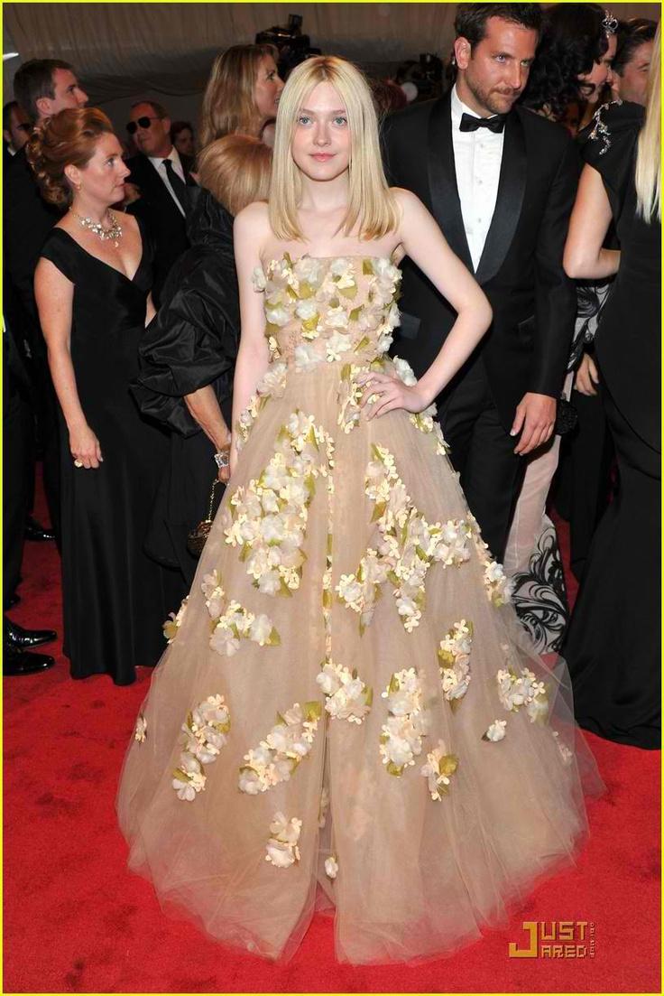 #Dakota #Fanning carries Alexander #McQueen gown with style.