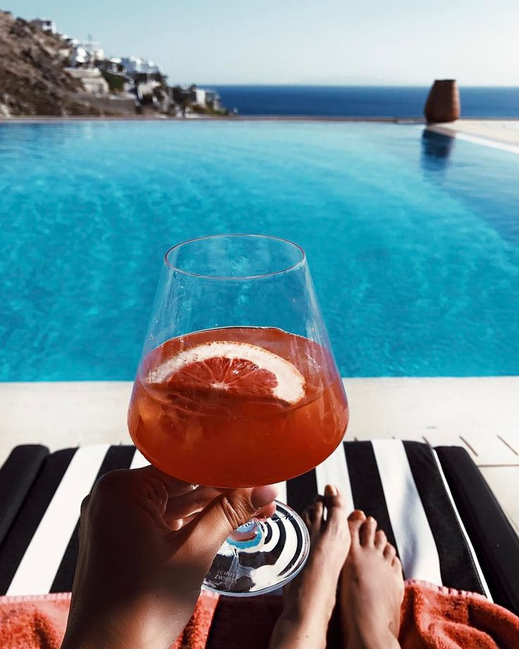 Campari with fresh grapefruit and orange juice ... This is how all Sundays should be spent ... #MyconianVillaCollection