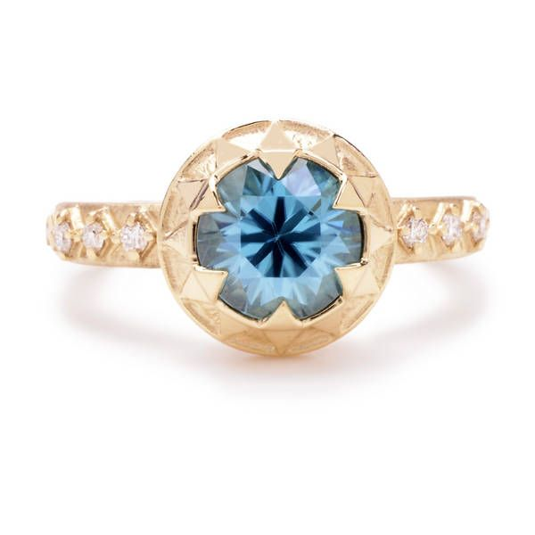 Custom created specially for Greenwich Jewelers, this ring features a blue zircon gem chosen by our gemologists for its exceptional cut and color.  Diamonds on the band add brilliance.