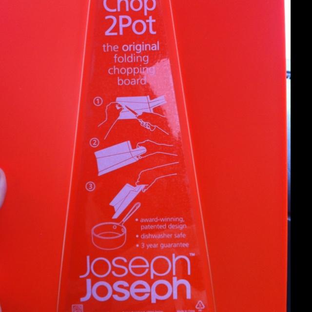 Found: Chop to pot cutting board by Joseph Joseph at Marshall's. I win