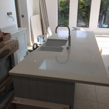 This is the Bianco Carrina from the Quartz range. It is an off-white with a marbling effect throughout.