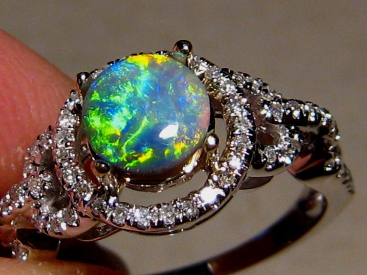 Natural Black Opal and Diamond Ring. This one has sold however similar rings are in stock now or one can be made to order at http://www.flashopal.com/Black-Opal-Ring-Diamonds-14k-Gold-Lime-Green-Stone/