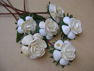 Flowers made of shells.  Unique alternative to live flowers.