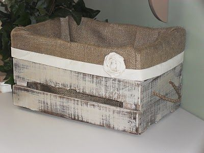 Aged crate with burlap liner.