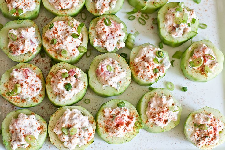 Cucumber Cups Stuffed with Spicy Crab  3 long cucumbers    1/4 cup sour cream    1/4 cup cream cheese, softened    3/4 cup crab meat, excess water removed    1 tsp hot pepper sauce (Tabasco or tapito)    1 tsp brown mustard    Salt and pepper to taste    1 tbs minced green onion    Garnish with chili powder or paprika if desired