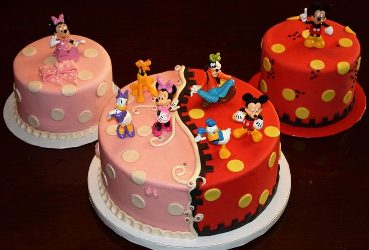 Client requested a cake for each kid, plus a large center cake  that had a dual personality.  All fondant and modeling chocolate with purchased toys.