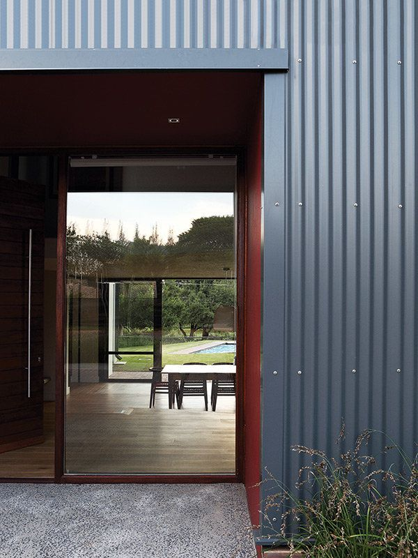 The home is clad in corrugated metal in the typical style for Home architecture style quiz